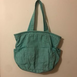 Teal Thirty-One tote with two outside side pockets